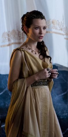 Bastian said she was a golden sun in that dress, as radiant and she she was poised. But Asya had never liked the golden silk dress; she felt like she was betraying herself and her image. She was not a sun, Bastian's wife or not, she was a moon; the last moon to be exact.