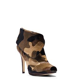 Go incognito-cool with our camo-print Kendra boots. Finished with hair calf for top-notch texture, this Open-toe style adds instant attitude to any ensemble. Temper the on-trend motif with neutral basics like a fine-knit sweater and a pencil skirt for a chic contrast at work or play.