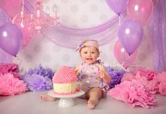 Sydney Cake Smash Photography Campbelltown pink and purple smash cake with chandelier and balloons. Cotton Cloud Photography by Courtney Anderson
