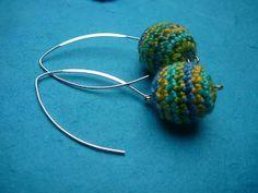 Crocheted earrings ball.