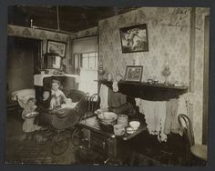 Four Children in a Tenement Room by Jessie Tarbox Beals, ca. 1916.