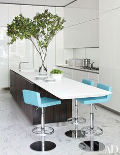 The kitchen of this Manhattan townhouse, remodeled by Delphine Krakoff of Pamplemousse Design, includes an island by Boffi and barstools by Derin.