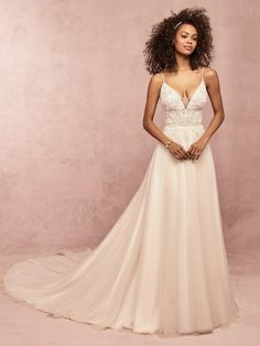 EUNICE - This boho wedding dress features a sheer bodice accented in lace motifs, with illusion scoop detail at the back. Beaded spaghetti straps complete the crisscross illusion detail at the plunging V-neck. A-line skirt comprised of tulle. Boho Wedding Dress, Designer Wedding Dresses, Bridal Dresses, Wedding Gowns, Prom Dresses, Formal Dresses, Bridal Elegance, Bohemian Bride, Bridal Boutique