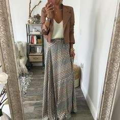Stunning wrap maxi skirt with amazing drape in rayon blend. Easy to dress up and…