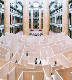 """THE BIG MAZE"", a huge curved wooden labyrinth installed in the hall of the National Building Museum in Washington DC, which thanks to its curves, reveals its"