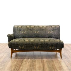 This mid century modern sofa is upholstered in a durable silk like fabric with a gray floral damask print and tiger animal accents. This sofa has a tufted back, 1 curved arm and a solid wood tapered leg base. Eye catching left side couch with a matching right side available!  #midcenturymodern #sofas #loveseat #sandiegovintage #vintagefurniture