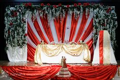 Red and White Indian backdrop by Beautiful Weddings