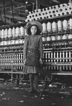 Young girl working in a cotton mill - 1911