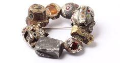 Karl Fritsch, brooch, 2012. Gold, silver, copper, iron, brass, bronze, various precious stones.