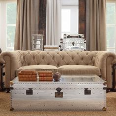 Living Room   Natural Fabric Tufted Sofa With A Shiny Metal Coffee Table  Aka Industrial Trunk
