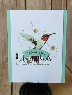 This thank you card has a very pretty hummingbird as the focal point. The color theme is pool party from Stampin Up!. The hummingbird itself is a 3-step stamp, then I added splatter spots in the background and then gold sequins to set everything off. The Thank You is stamped on a banner raised. The inside is blank and ready for your handwritten sentiment or I can stamp a sentiment of your choice prior to mailing. I have 3 of these cards and they similar but do have a few differences. It is…