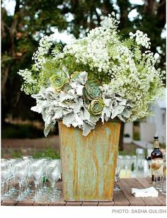Statement arrangements are a great way to tie into other elements of the reception, such as the bar, gift or place card table.