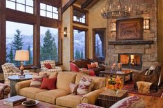 Extra large great room, nicely divided into multiple seating areas in this Montana log home