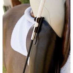 A much easier way to carry a crop/whip. Whip Clip from Dover Saddlery. For my sidesaddle
