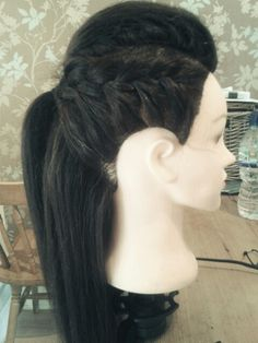Two side french plaits with a middle back-combed section