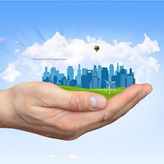 """Motivational Prezi Template with a """"world at your fingertips"""" concept.  Hand is holding a small city with skyscrapers, green grass and animated wind turbines.  Template can also be used with any other presentation topics.  Includes a 3D background with clouds, light rays and a flying hot air balloon."""