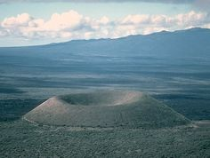 Cinder Cone or Scoria Cone, Hawaii  Cinder cones are piles of volcanic ash that build up around explosive vents, usually on larger volcanoes. They represent a single eruption episode. (more below)
