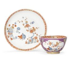 A Meissen purple-ground teabowl and saucer, circa 1735.Painted in Kakiemon style, the teabowl reserved with two shaped quatrelobe panels painted with two quail by a flowering prunus branch, and flowering peonies, respectively, the sides with indianische Blumen reserved against the purple ground, the saucer similarly decorated, the rims with a band of tight iron-red scrolling foliage divided by four gilt floral motifs