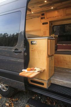 This van conversion was built for taking extended weekend trips, with a double drop down bed, large kitchen galley, and a modular bench seat with a dog bed. Motorhome Interior, Campervan Interior, Van Conversion Interior, Camper Van Conversion Diy, Motorhome Sprinter, Tiny House Big Living, Build A Camper Van, Bus Living, Sprinter Van Conversion