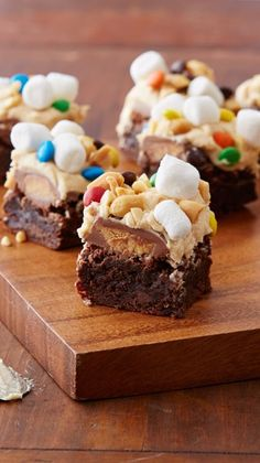 A brownie for candy lovers! Piled high with peanut butter cups, M&M's, marshmallows and cocktail peanuts, these decadent squares are bound to be a bake-sale hit.