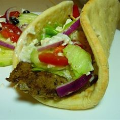 Traditional Gyro Meat - AMAZING!  triple the garlic, let meat set 2 hrs.  top with tomatoes, Sabra tzatziki, crumbled feta, & drizzle with balsamic vinegar.  Saute chopped cabbage in coconut oil, saffron & curry for a few minutes, then add to pita.  THE BEST GYRO EVER!