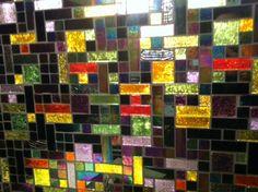 An amazing kitchen backsplash in dichroic glass tiles!