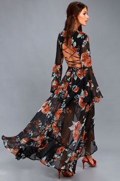 Blooming fields and misty mountains come to mind whenever we think of you in the Petals on the Breeze Black Floral Print Maxi Dress! Dreamy black chiffon is dressed up with a rust orange, slate blue, and green floral print across a surplice bodice, with long, sheer, bell sleeves, and a lace-up back. Ruffled high-low maxi skirt has a sexy front slit. Top button and hidden back zipper/clasp.