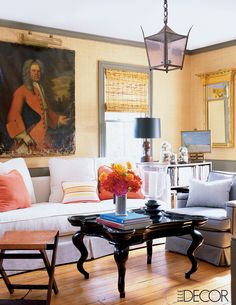 In the living room of this Hamptons home, an 18th-century portrait brings the perfect amount of old world charm to an otherwise modern room. Tour the rest of the home.   - ELLEDecor.com