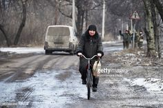 civilians on bikes in Ukraine