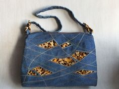 Fancy Stitched denim purse -- (interesting cut outs, reverse applique and sewing machine stitching) --  by Dublirina