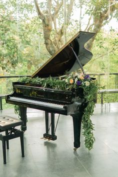 Grand Piano adorned with Greenery & FlowersYou can find Grand pianos and more on our website.Grand Piano adorned with Greenery & Flowers Piano Art, Piano Music, Grand Piano Room, Piano Wedding, Piano Living Rooms, Flautas, Baby Grand Pianos, Music Aesthetic, Piano Lessons