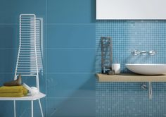 Nice Spectacular Stylish Bathroom Wall Providing With Light Blue Tile Wall Including Metal Towel Shelves Beside Wooden Floating Sink Including Rectangular Mirror Wall Mount Spectacular Stylish Bathroom Wall Providing Dramatic Impression Home design