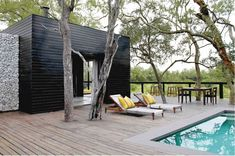 A well-designed safari lodge should reinforce the design story of a place without attempting to reinvent it; and it should tread lightly on the earth – disrupting quietly and without causing harm. As it is at Silvan Safari. Tropical Architecture, Amazing Architecture, Game Lodge, Beach Road, Thatched Roof, Architect Design, Dark Colors, Lodges, Swimming Pools