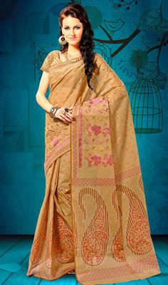 Beige Shade Embroidered Cotton Saree Look dazzling draped in this beige shade cotton saree. Embroidered floral patterns, printed decorative buttas and printed bold paisley patterns accentuate the beautiful look of the saree. Comes with a matching stitched round neck blouse with 6 inches sleeves. #BuyDesignerSareesOnline #StyleDesignerCottonSarees