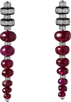 CARTIER  - Platinum, ruby beads, onyx, brilliant-cut diamonds.