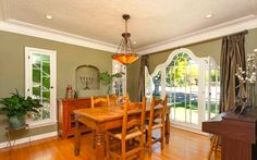 Dining room with niches and picture window. 1927 Spanish style home in Glendale, 799k