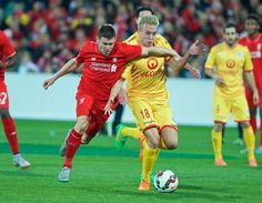 ADELAIDE, AUSTRALIA - Monday, July 20, 2015: Liverpool's James Milner in action against Adelaide United's James Jeggo during a preseason friendly match at the Adelaide Oval on day eight of the club's preseason tour. (Pic by David Rawcliffe/Propaganda)