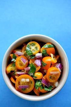 Delicious salsa for seafood made with tiny kumquats, cilantro, and red onion.