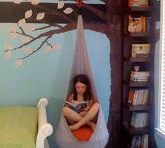 Tree bookshelf and reading swing. Kids room