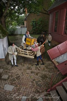 Unloading tea into a merchant's basement from a cart at Colonial Williamsburg, Photo by David M. Doody