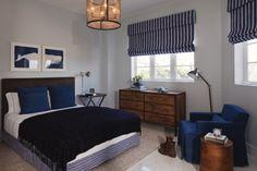 Nautical style bedroom navy blue medium wood tones