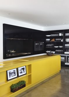 Powerful colour blocking on modern kitchen cabinets | La House by Studio Guilherme Torres. #black #yellow