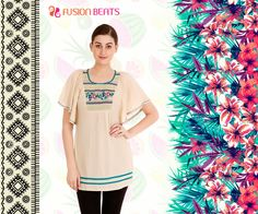 Cream colored tunic enhanced with teal shade embroidery. Tune into our #ClubTropicana and explore the exotic prints from our #FreeSpirit collection.