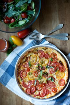 This tomato tart sums up summer. Sweet tomatoes and basil sit on top of a mascarpone cheese filling.
