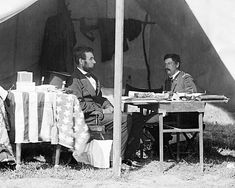 President Abraham Lincoln meets with General George McClellan at Antietam a few weeks after the end of the battle in October of 1862.