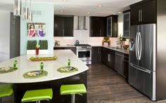 Bright colors and a backdrop of pale pastels soften ultra modern kitchen design