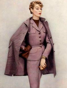 1952 Jean Patchett wearing a suit and cape by Klein & Klein Sportswear