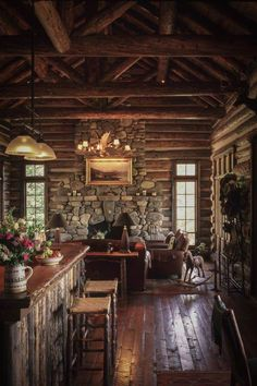 Log Cabin with river rock fireplace.