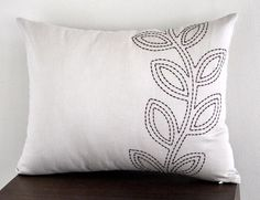 Modern, contemporary pillow which made from cream linen and embroidered with dark brown leaves motif.  This pillow cover is available in size 12 x 16,