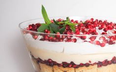 "Nothing says ""fancy"" like a trifle — it's the perfect dessert! Layers of pomegranate jelly, vanilla sponge, pomegranate arils, custard, and coconut cream make this a must-have for your holiday table. Trifle Cake, Trifle Desserts, Trifle Recipe, Vegan Dessert Recipes, Vegan Sweets, Vegan Food, Dessert Trifles, Christmas Trifle, Vegan Christmas"
